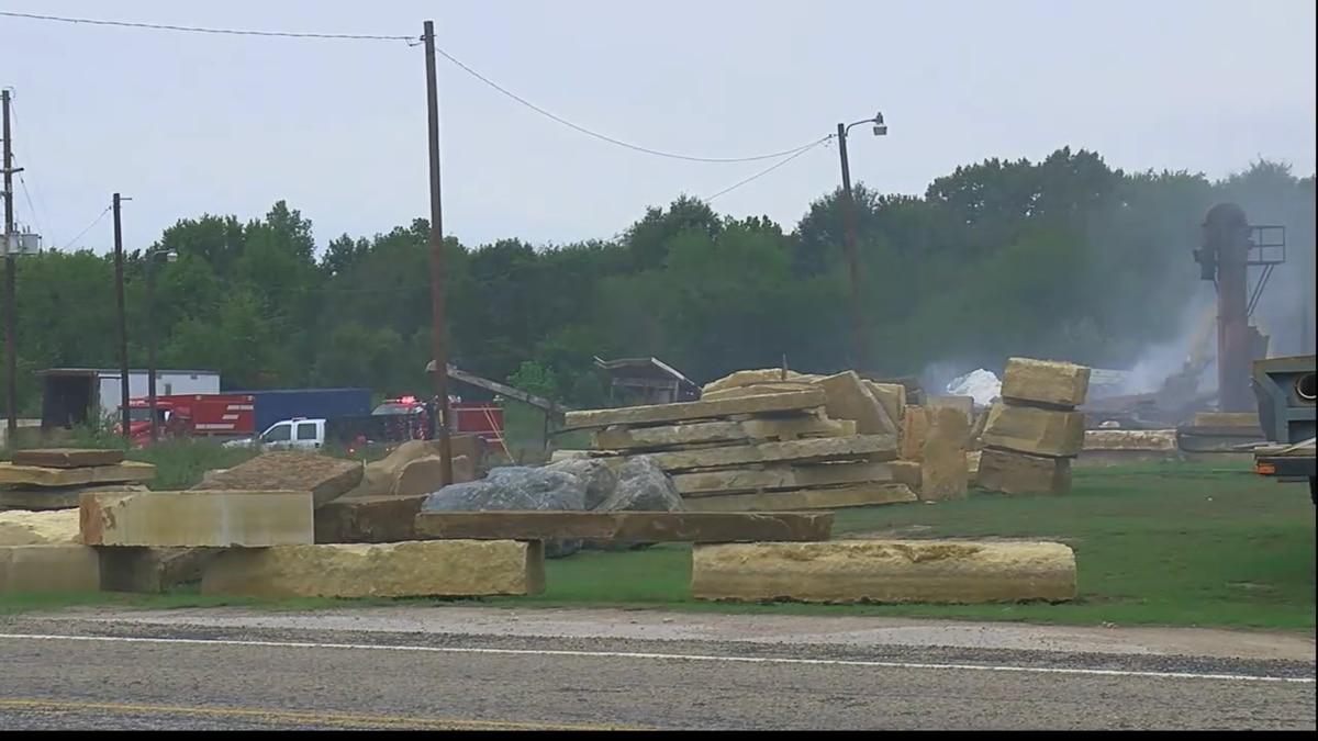 Area business owners were allowed back within the half-mile radius of the fire after officials...
