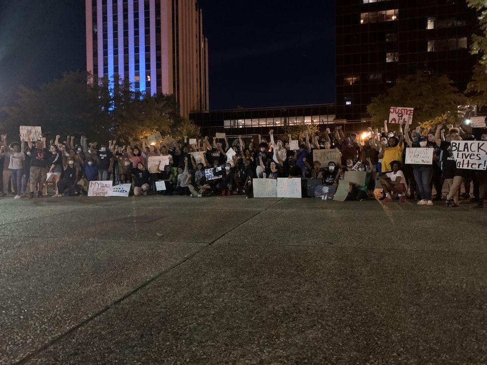 As the sun set over Tyler, a group numbering over 100 people gathered on the square downtown...