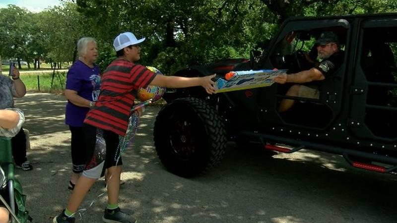 Jair Egan accepts a gift during his birthday parade.