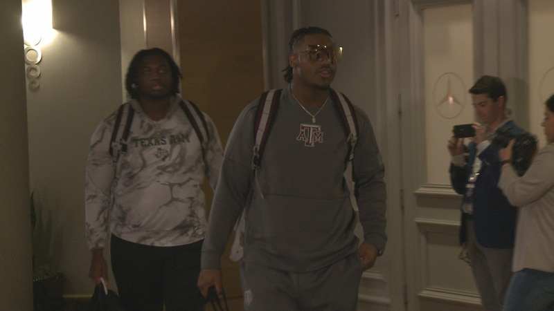 Texas A&M Football players DeMarvin Leal and Kenyon Green walk into the Wynfrey Hotel in...