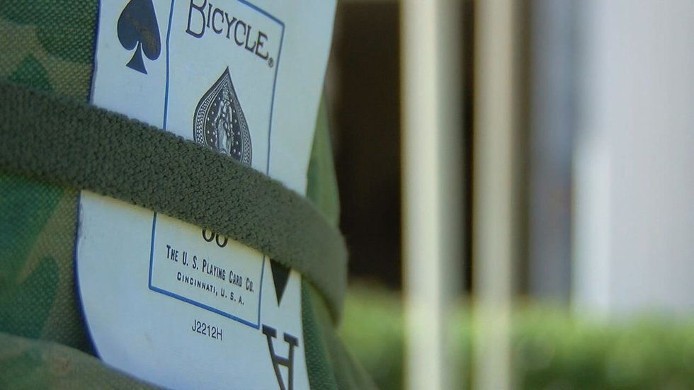 A soldier's cross was planted outside the chapel. (Source: KLTV)