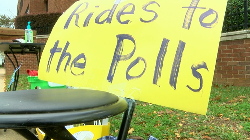 Students help others get to the polls.