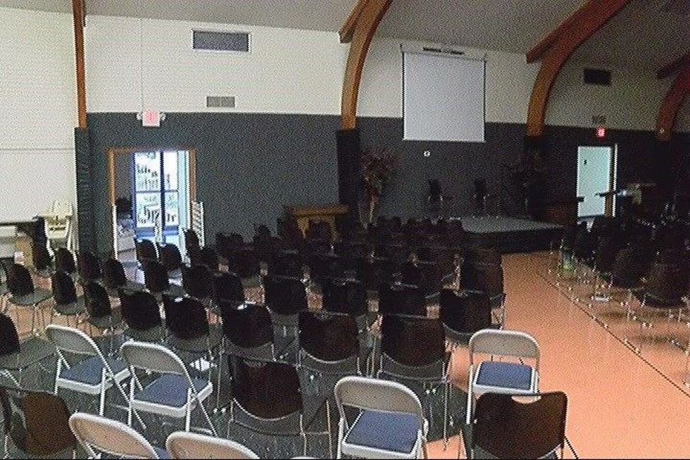 Sunday services are being held in the fellowship hall, just feet from the work taking place in...