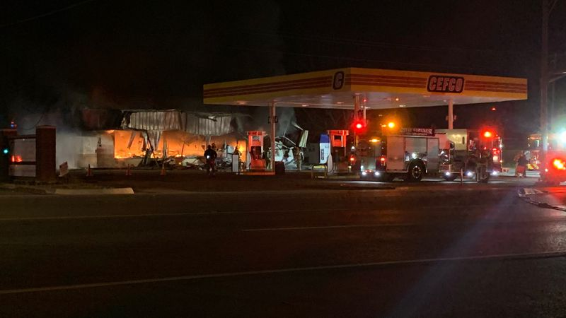 Fire crews work to tame remaining hot spots after large fire at CEFCO gas station in Chapel Hill.