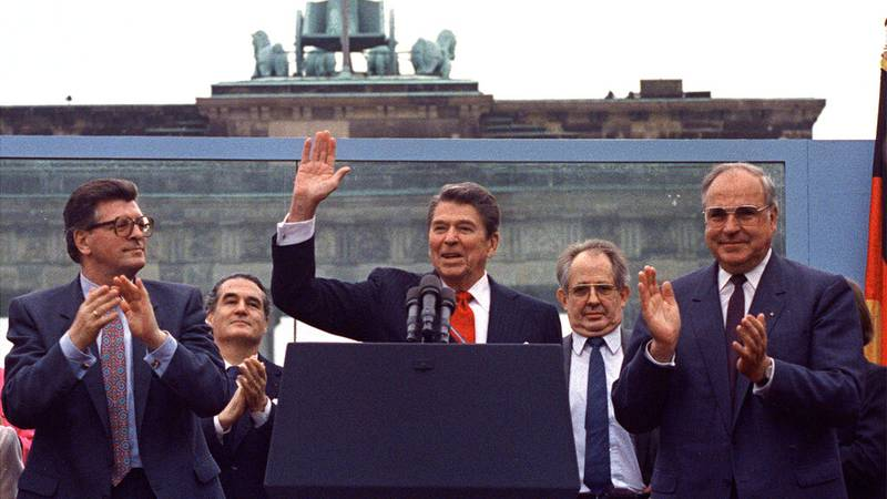 In this June 12, 1987 file photo U.S. President Reagan acknowledges the crowd after his speech...