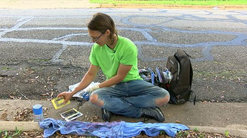 East Texas native paints house numbers, designs on Tyler curbs