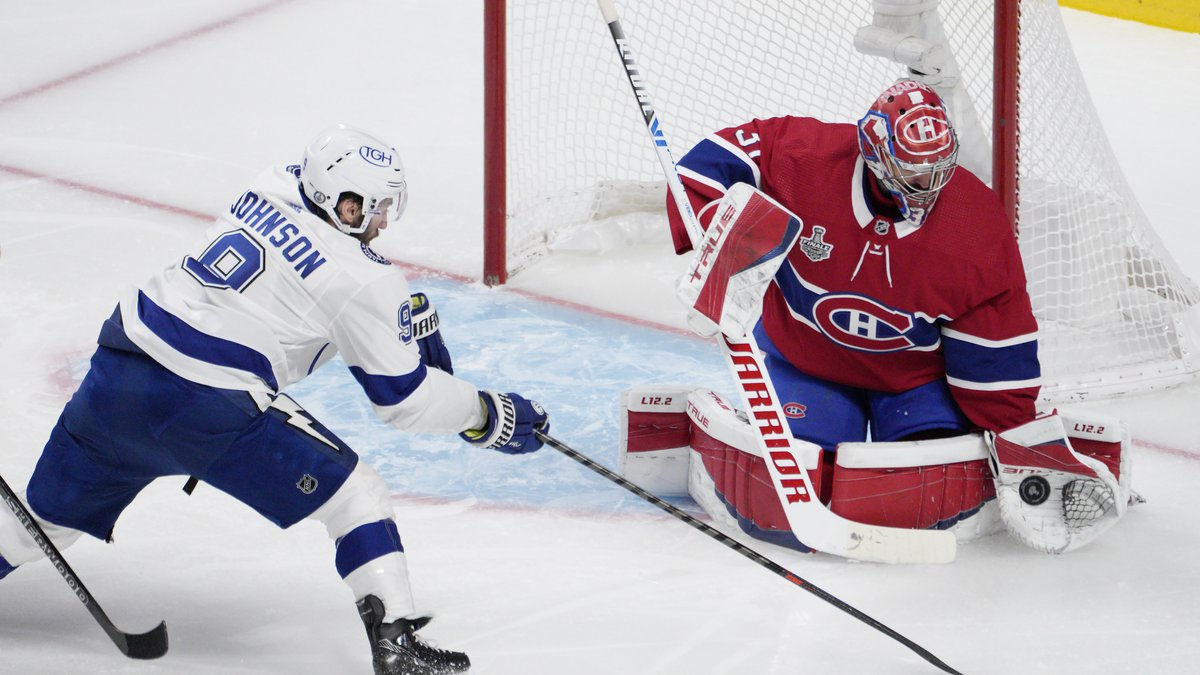 Montreal Canadiens goaltender Carey Price, right, makes a save against Tampa Bay Lightning...