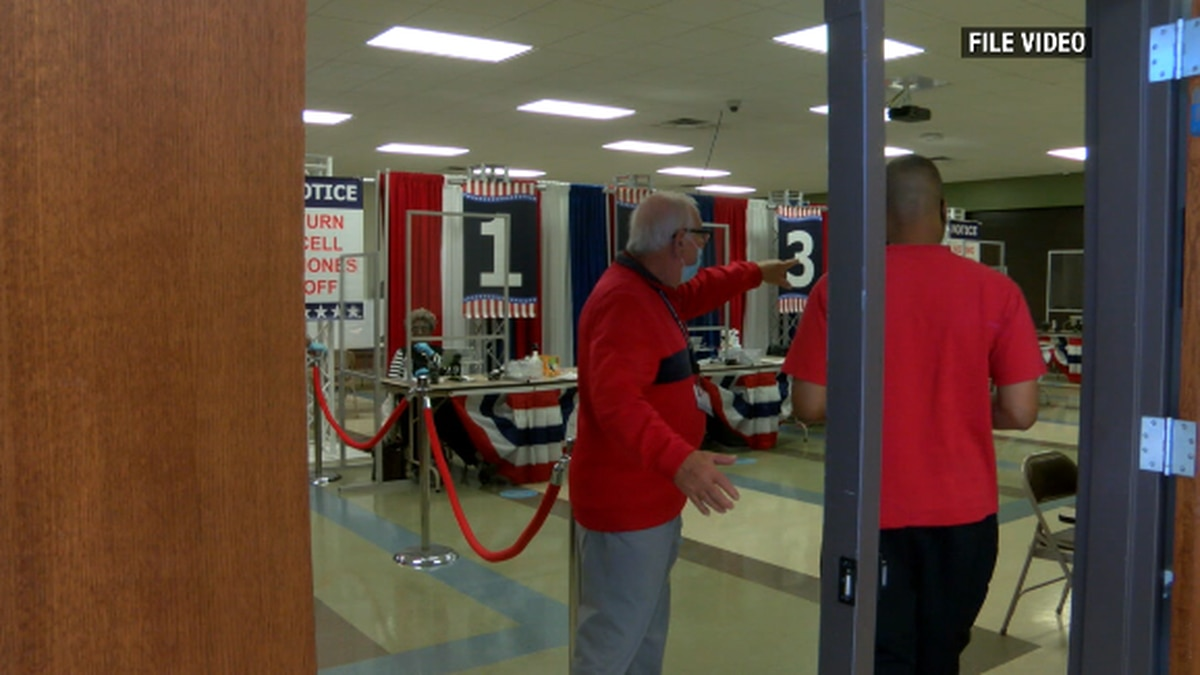 A poll worker directs a voter during early voting in Nacogdoches County.