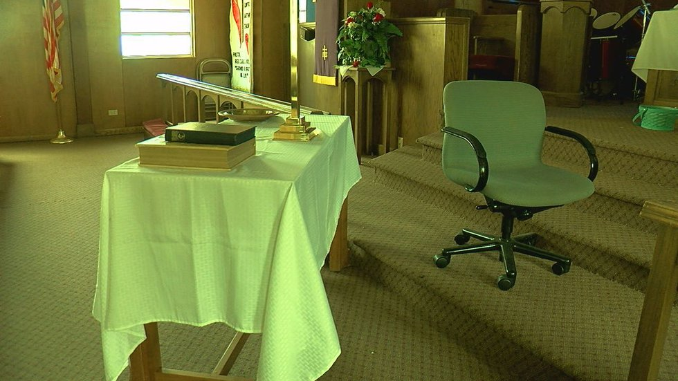 It appears the vandal slammed a chair into the communion table inside the sanctuary.