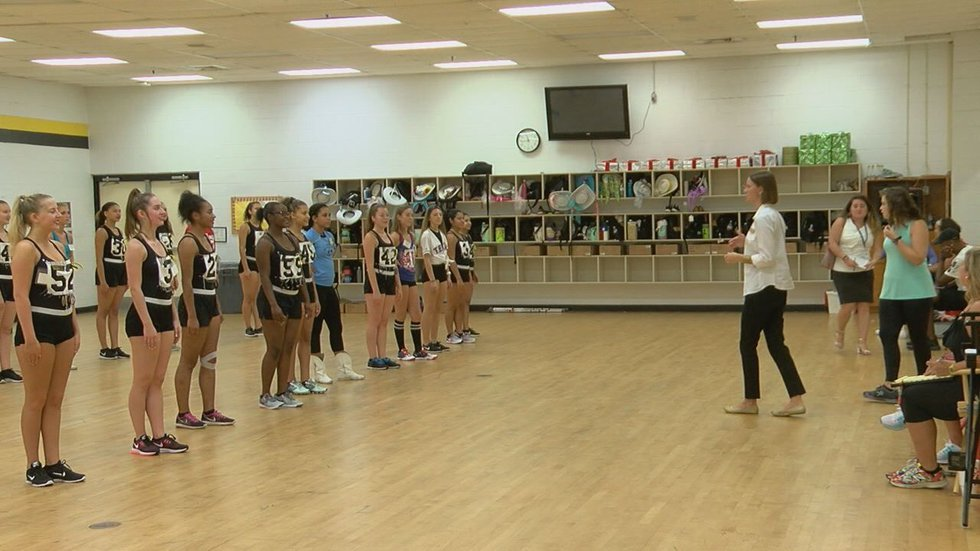 Director Jasilyn Schafer with the 70th Apache Belles line.