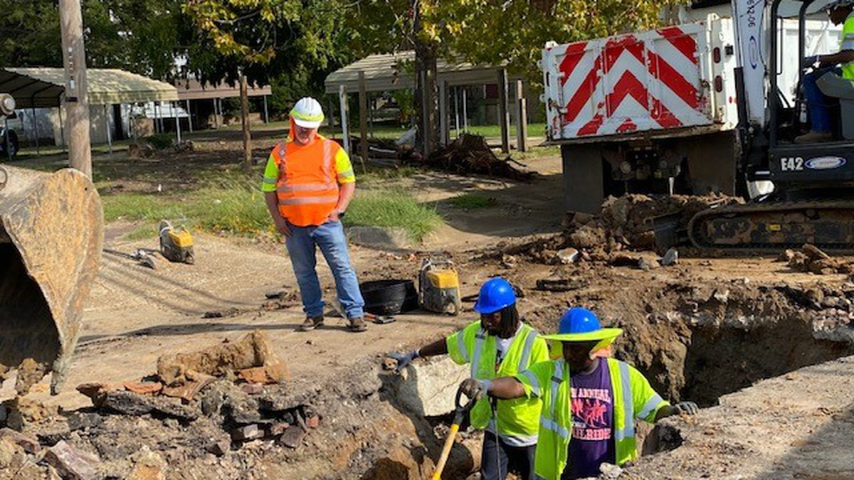 There's a sinkhole under the road on W 7th Street at Pine Street in Texarkana, Texas.