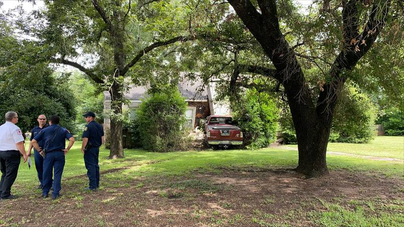A driver has crashed into a home located off Troup Highway.