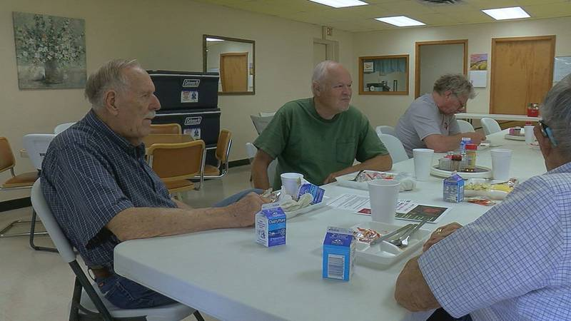 Senior citizens come for the meal, but stay for the conversation at the Emory Senior Center.