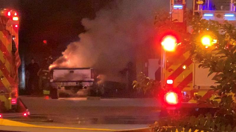 Firefighters work to tame flames after truck catches fire