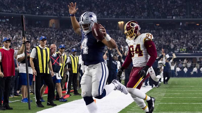 Nov 24, 2016; Arlington, TX, USA; Dallas Cowboys quarterback Dak Prescott (4) eludes Washington...