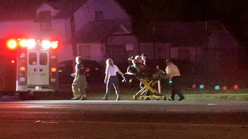 Woman involved in reported crash is taken by EMS officials to hospital via ambulance