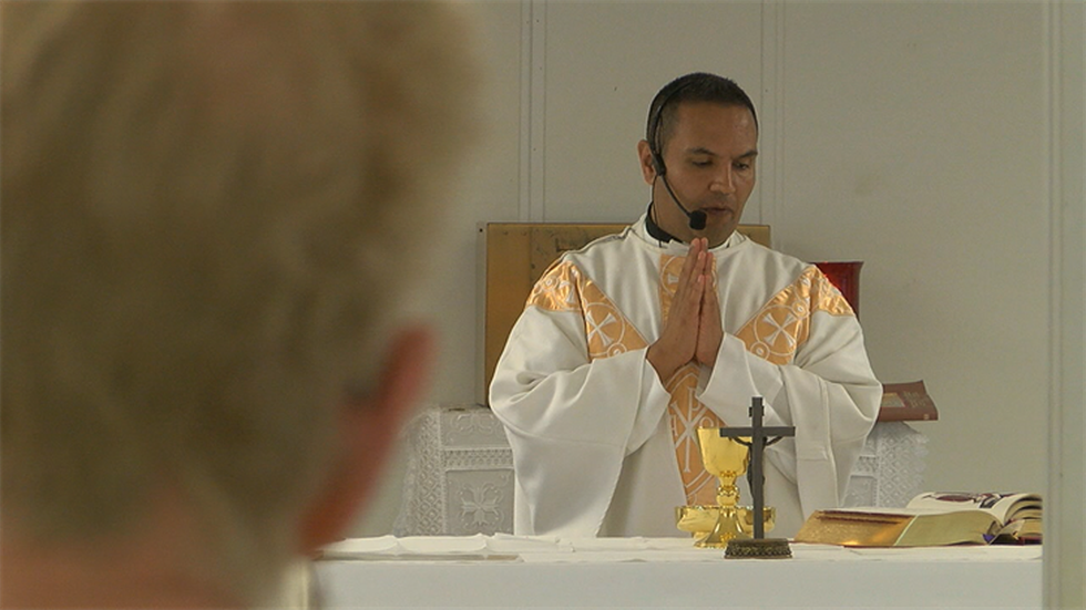 Father Victor Hernandez, pastor of St. John the Evangelist, says this test of faith has become...