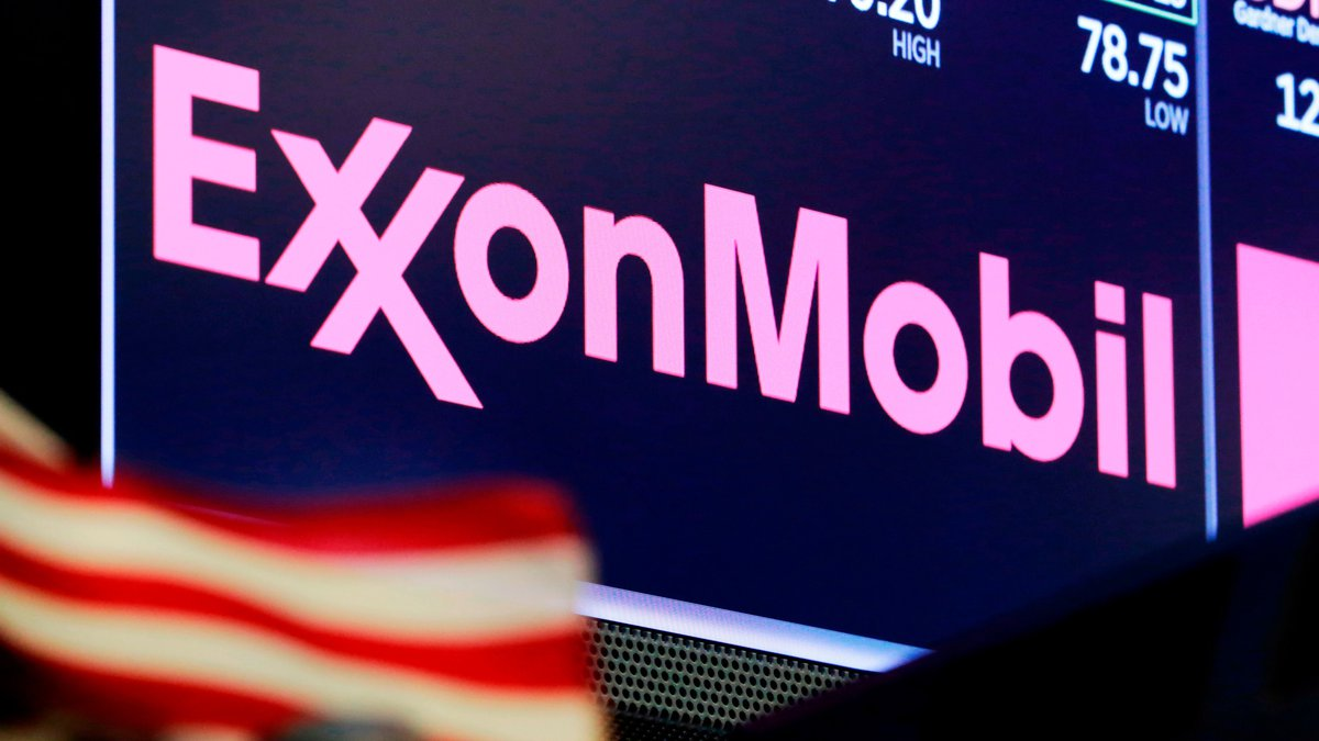 Exxon Mobil swung back to a profit and topped expectations on profit and revenue during the...